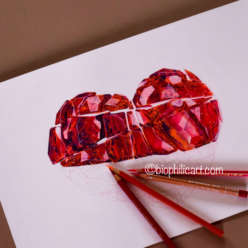 Picture showing how to draw a red Gem heart in colored pencil.